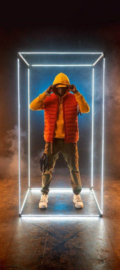 stylish-rapper-poses-in-illuminated-cube-BCRQ2AT.jpg